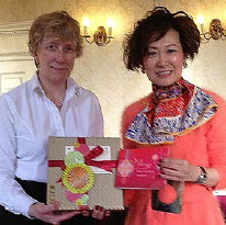 Jennifer Pierce, President of LES Britain & Ireland, receives a gift from Yvonne Chua.