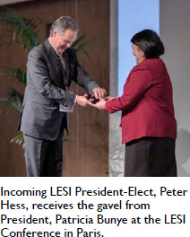 Incoming LESI President-Elect, Peter Hess, receives the gavel from President, Patricia Bunye at the LESI Conference in Paris.