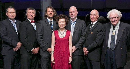 Yvonne Chua, Past-President LESI, center, with the LESANZ Presidents at their 40th Annual Meeting. From left, Tim Jones, Mark Horsburgh, Simon Rowell, Rob McInnes, Rodney Deboos, and Des Ryan (wearing his Gold Medal).